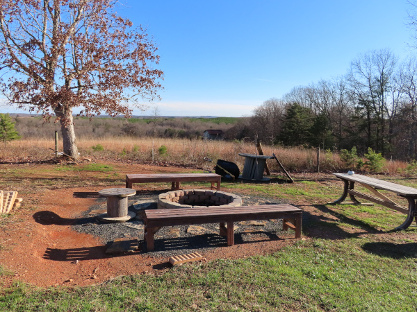 The firepit with benches around it and some of the view you get from that vantage point.
