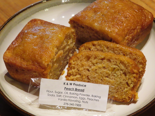 Peach Bread from K&W Produce cut and plated, showing off its moisture and texture.
