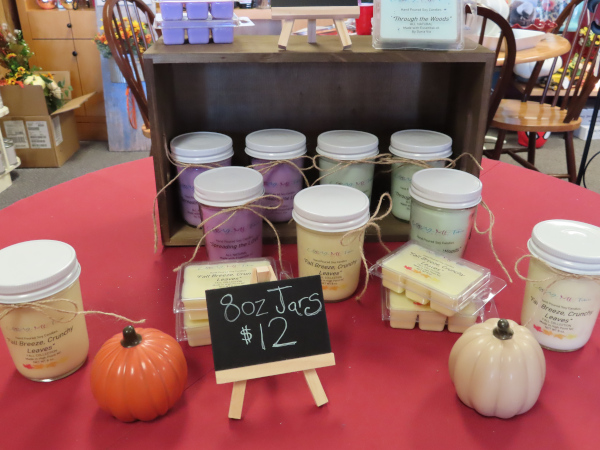 A new vendor is selling tarts and candles