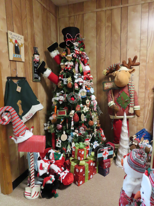 Christmas tree with Santa's legs sticking up and a YuleTide Moose