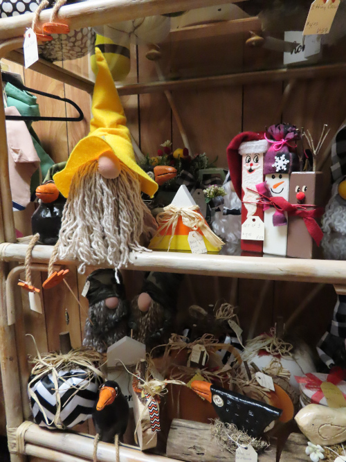 Shelves of hand made decorations for the entire end of the year - Halloween, Fall, and Christmas
